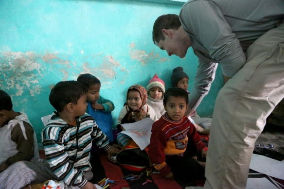 _John with Slum School Children